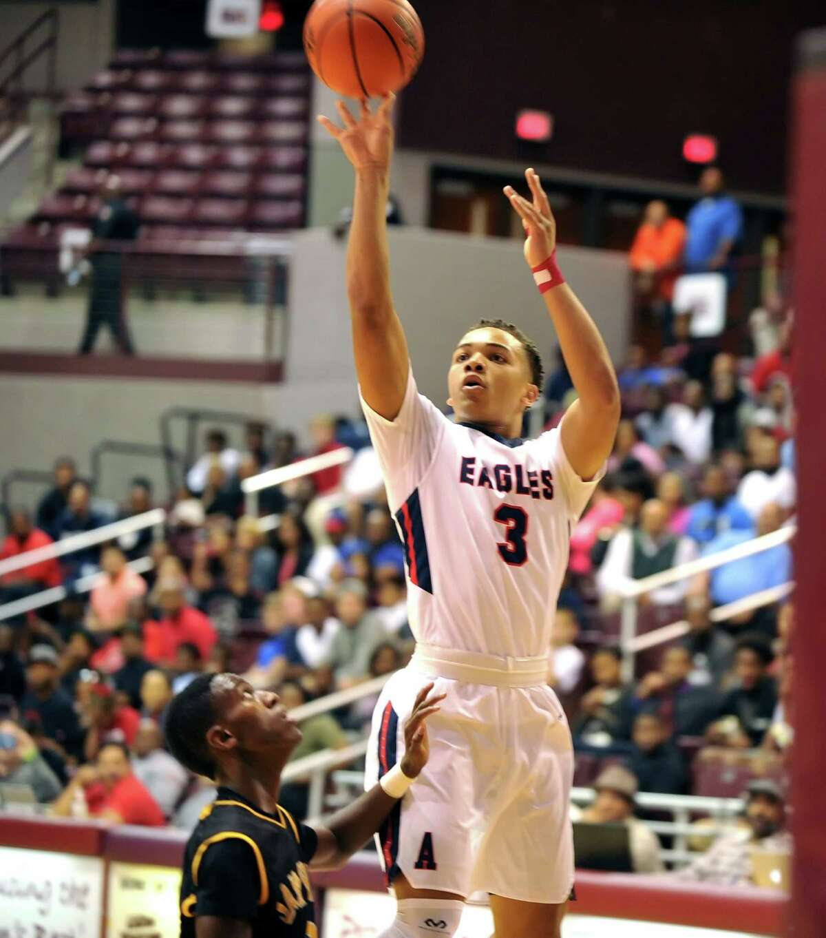 Atascocita High School basketball team defeated Sam Houston in the RCS Season Opener held at M.O. Campbell Center, 11-16-2015. Right, Carsen Edwards (3) of Atascocita, had a clear shot and scored on this layup.
