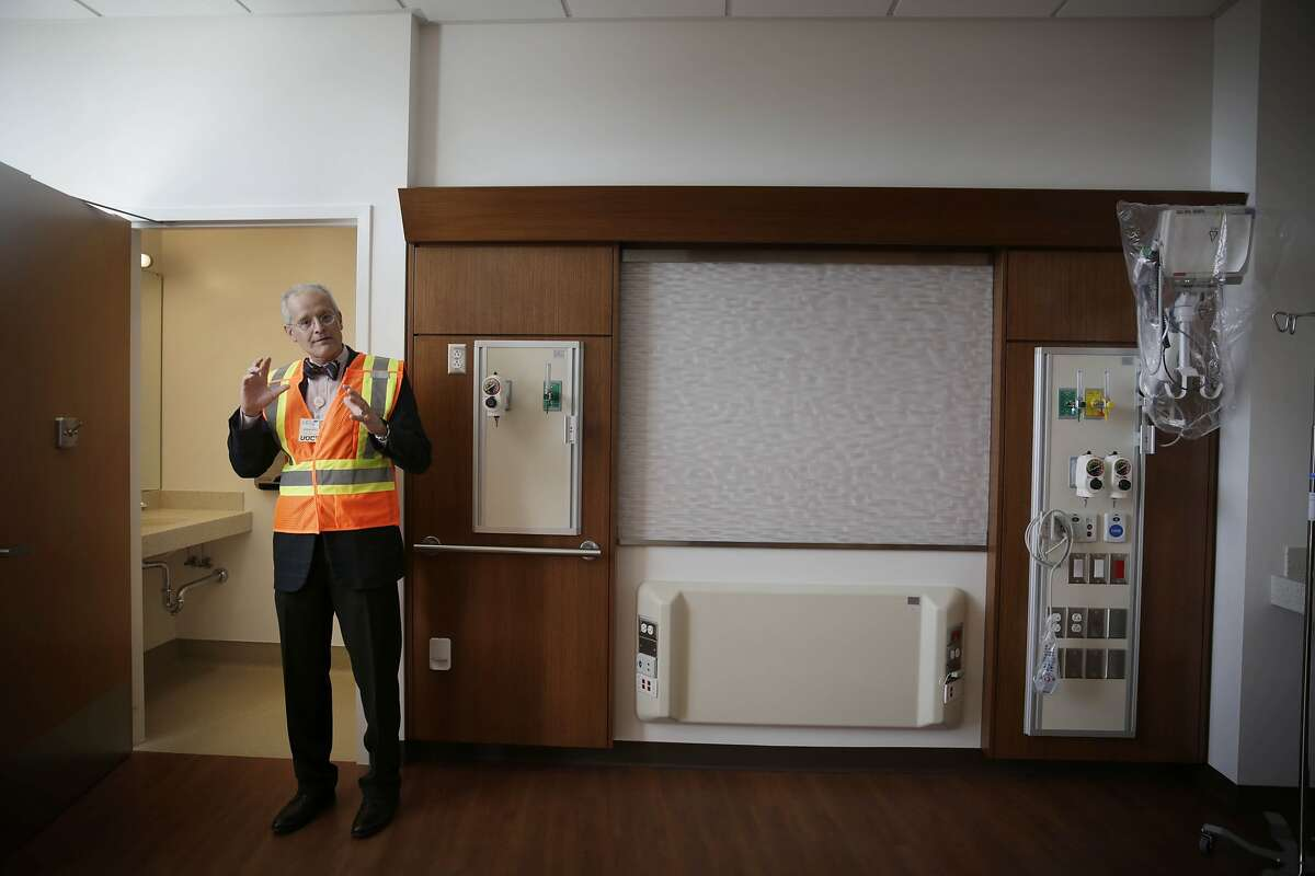 Edgar Pierluisssi, director Acute Care for the Elders Unit, Zuckerberg San Francisco General, shows a patient room in the Acute Care for Elders Unit during a tour at the Priscilla Chan and Mark Zuckerberg San Francisco General Hospital and Trauma Center on Tuesday, November 17, 2015 in San Francisco, Calif.