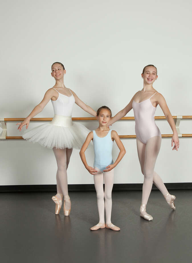 """Darien dancers, from left, Taylor DeVito, Anastassia Grytsenko and Claire Batchelor are among the cast members of the Ballet Etudes Company's production of """"The Nutcracker"""" at Westport Country Playhouse. Photo: Contributed / Contributed Photo / Darien News"""