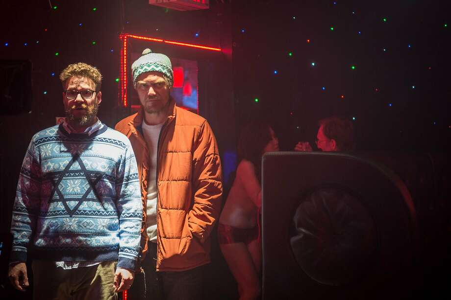 Seth Rogen (left) as Isaac, with Michael Shannon as the intense pot dealer Mr. Green. Photo: Sarah Shatz, Associated Press