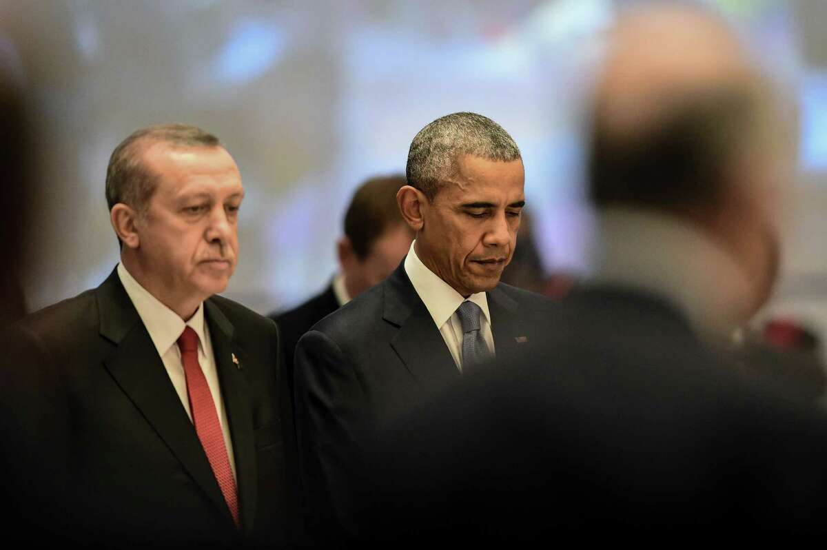 President Barack Obama observe a minute of silence to honor the victims of terror attacks in Paris with other world leaders, including Turkish President Recep Tayyip Erdogan during the start of the G20 summit in the Turkish resort of Antalya. A reader says he hopes the U. S. enacts strict security measures in the wake of the attacks.