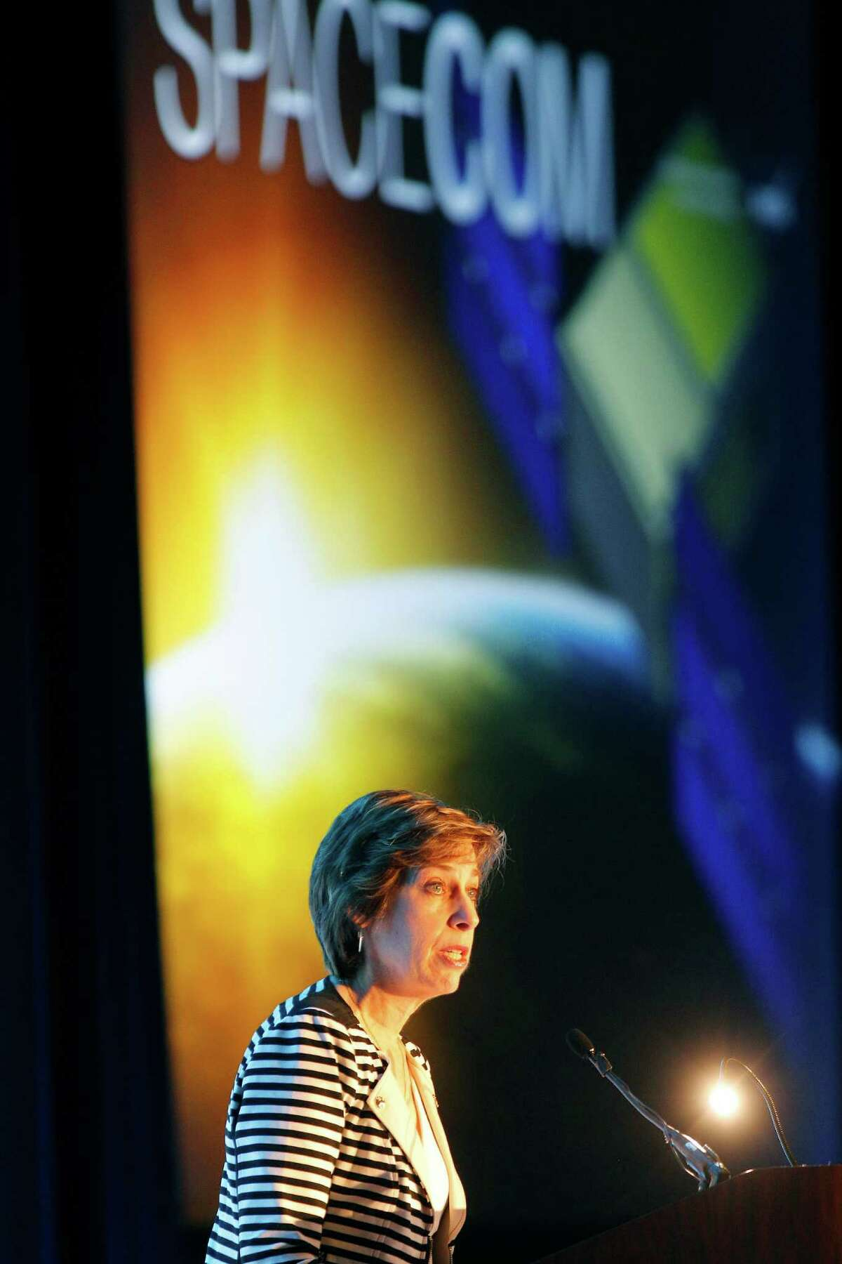 Director of NASA Johnson Space Center Dr. Ellen Ochoa welcomes SpaceCom attendees Tuesday, Nov. 17, 2015, at the George R. Brown Convention Center in Houston. Maj. Gen. Charles Frank Bolden Jr., administrator of NASA, gave a keynote speech during SpaceCom. ( Steve Gonzales / Houston Chronicle )