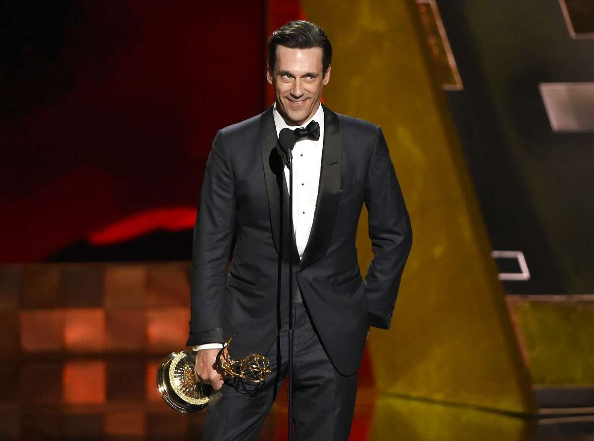 """Jon Hamm accepts the award for outstanding lead actor in a drama series for """"Mad Men"""" at the 67th Primetime Emmy Awards on Sunday, Sept. 20, 2015, at the Microsoft Theater in Los Angeles. (Photo by Chris Pizzello/Invision/AP)"""
