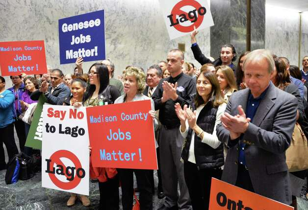 Opponents of the Lago casino protest in the well of the LOB Tuesday Nov. 17, 2015 in Albany,NY.  (John Carl D'Annibale / Times Union) Photo: John Carl D'Annibale / 00034290A