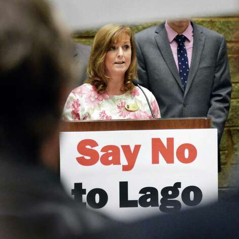Turing Stone Resort and Casino front office manager Kim Lane addresses opponents of the Lago casino demonstrating in the well of the LOB Tuesday Nov. 17, 2015 in Albany, NY.  (John Carl D'Annibale / Times Union) Photo: John Carl D'Annibale / 00034290A