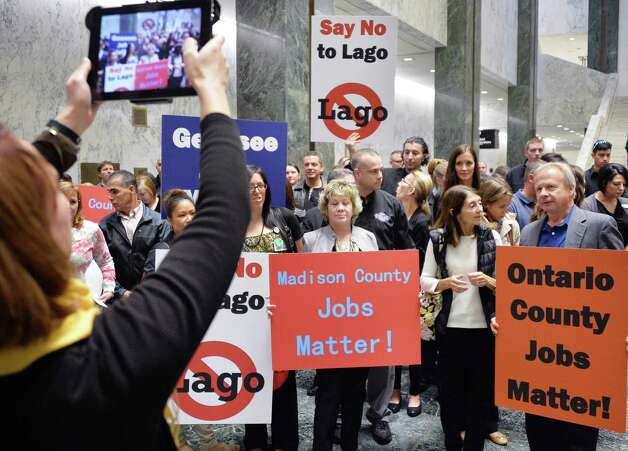 Opponents of the Lago casino protest in the well of the LOB Tuesday Nov. 17, 2015 in Albany, NY.  (John Carl D'Annibale / Times Union) Photo: John Carl D'Annibale / 00034290A