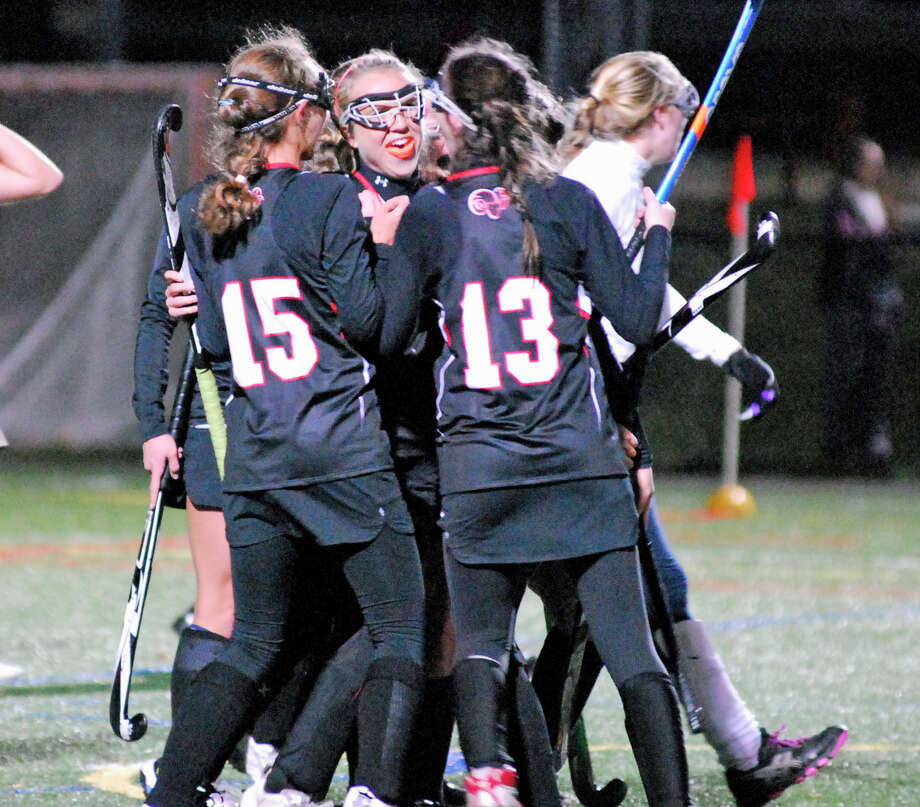 New Canaan's Tigger Nesbett, center, is greeted by her teammates after scoring the first goal of her team's Class M semifinal game against Lauralton Hall on Tuesday, November 17th 2015  at Weston High School. Photo: Ryan Lacey/Staff Photo / Westport News Contributed