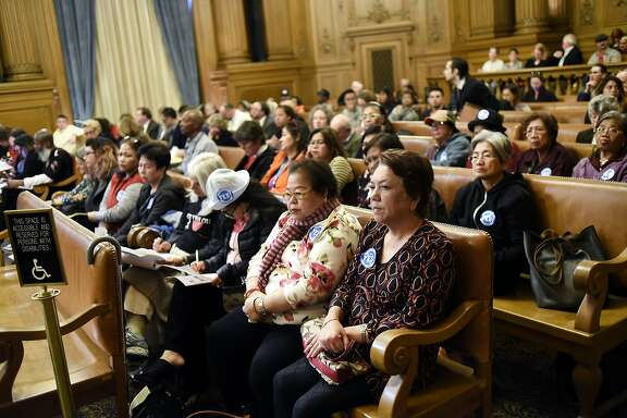 A group of women from the SOMA area sit in support of the 5M project during a board of supervisors meeting at City Hall in San Francisco, Calif. Tuesday, November 17 2015.