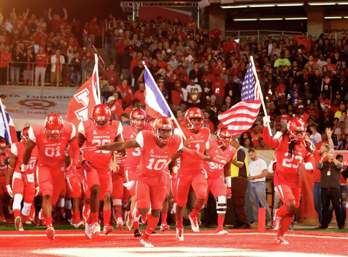 UH players stormed the field Saturday against Memphis for the second sellout in the history of TDECU Stadium.