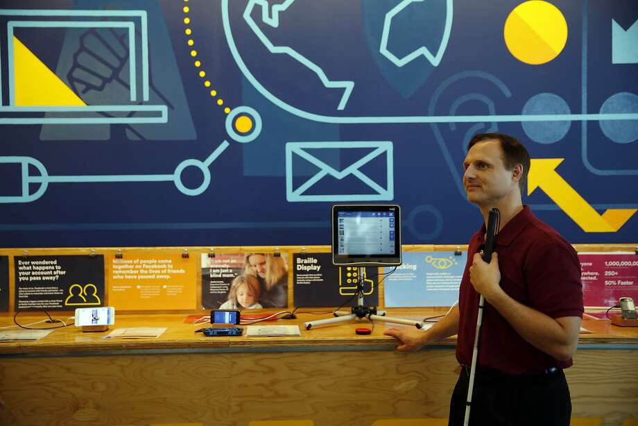 """Matt King, Facebook accessibility specialist, stands near the """"empathy lab"""" at Facebook headquarters in Menlo Park, California, on Tuesday, Nov. 17, 2015. Photo: Connor Radnovich, The Chronicle"""