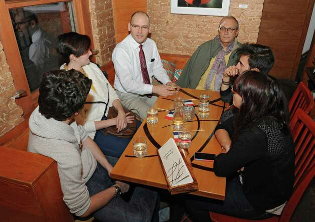 From left, Pierre-Luc Valentin, Melanie Escassut, Frederic Meni, Jean-Francais Briere, Francais Battmann and Audrey Marcon meet up at the Lark & Lily Wine Bar and Kitchen to talk about last weekOs terror attacks in Paris on Tuesday, Nov. 17, 2015 in Albany, N.Y. The french citizens living in the Capital Region are coming together in a very French act of defiance, restaurant owners in Paris are calling everyone to the bar or Otous au bistrot.O (Lori Van Buren / Times Union) Photo: Lori Van Buren / 10034323A
