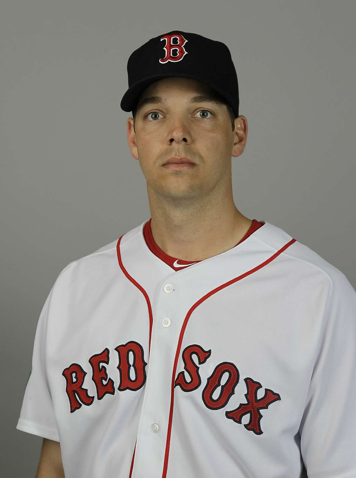 FILE - This is a 2012 file photo showing Boston Red Sox baseball player Rich Hill. Hill starts spring training with a heavy heart. Hill reported to Boston's camp on Thursday, March 6, 2014, following the death of son Brooks, who was less than 2 months old when he died on Feb. 24. (AP Photo/David Goldman/File)