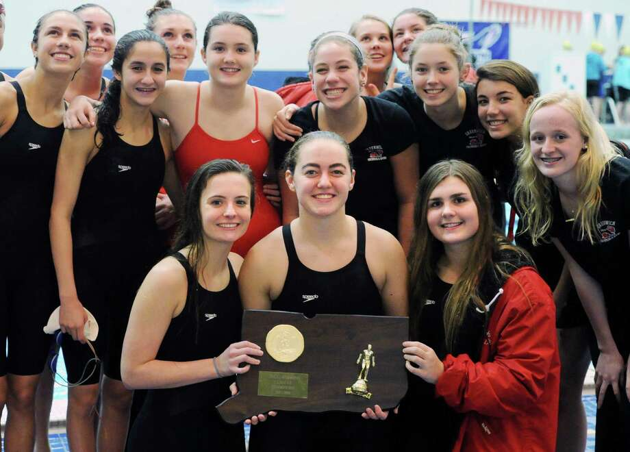 Bottom row let to right, Greenwich swimmers Brooke Collins, Riley Ennis and Sara Bellamy hold their state championship trophy as they and their teammates celebrate their CIAC Class LL Swimming Championship victory at Southern Connecticut State University, New Haven, Conn., Tuesday, Nov. 17, 2015. Photo: Bob Luckey Jr. / Hearst Connecticut Media / Greenwich Time