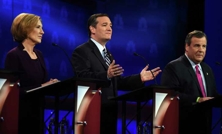Republican Presidential hopeful Ted Cruz (C) gestures as Carly Fiorina (L) and Chris Christie look on during the CNBC Republican Presidential Debate, October 28, 2015 at the Coors Event Center at the University of Colorado in Boulder, Colorado. AFP PHOTO/ ROBYN BECKROBYN BECK/AFP/Getty Images