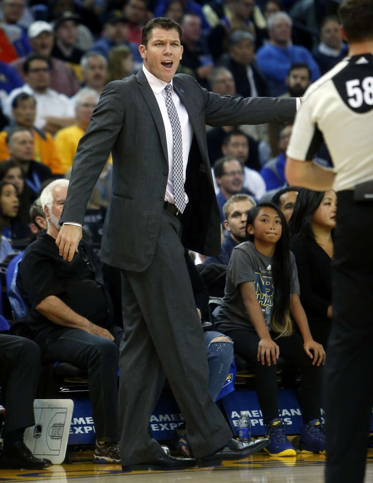Golden State Warriors' interim head coach Luke Walton argues a call in 2nd quarter against Toronto Raptors during NBA game at Oracle Arena in Oakland, Calif., on Tuesday, November 17, 2015.