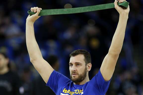 Golden State Warriors' Andrew Bogut warms up before playing Toronto Raptors during NBA game at Oracle Arena in Oakland, Calif., on Tuesday, November 17, 2015.