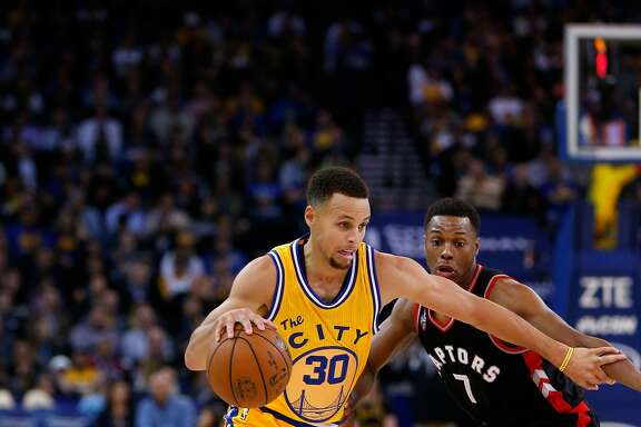 OAKLAND, CA - NOVEMBER 17:  Stephen Curry #30 of the Golden State Warriors drives on Kyle Lowry #7 of the Toronto Raptors at ORACLE Arena on November 17, 2015 in Oakland, California.  NOTE TO USER: User expressly acknowledges and agrees that, by downloading and or using this photograph, User is consenting to the terms and conditions of the Getty Images License Agreement.  (Photo by Ezra Shaw/Getty Images)