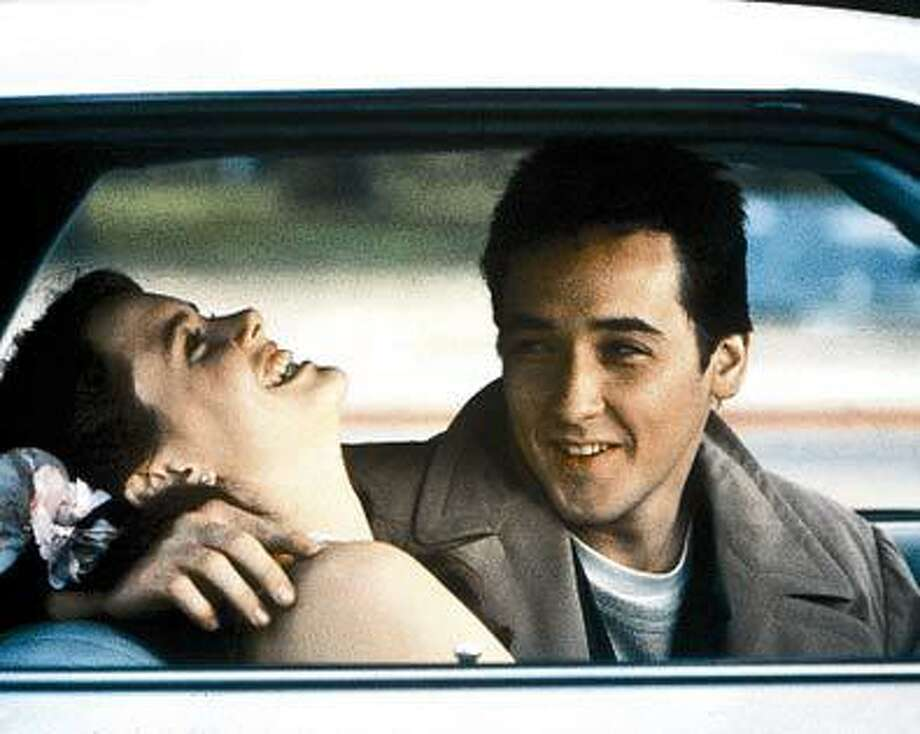 "John Cusack and Ione Skye star in the classic 1989 romantic comedy ""Say Anything.""  Cusack will take part in a screening of the movie at the Tobin Center for the Performing Arts. Photo: Www.ew.com, SFC"