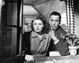 CASABLANCA:  Ingrid Bergman and Humphrey Bogart looking out window in the Paris flashback.