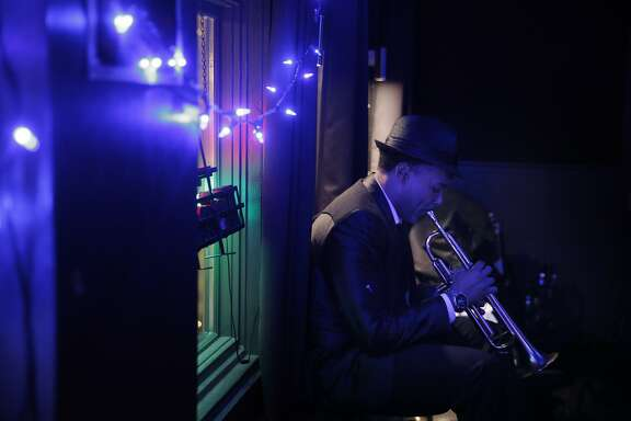 Geechi Taylor practices his trumpet before The Lucky Devils played a showcase for people who are considering hiring them for their weddings at the Neck of the Woods in San Francisco, Calif., on Tuesday, November 17, 2015.