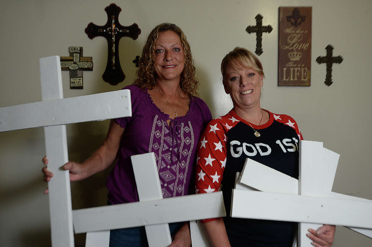Krissy Boudreaux (left) and Tina Boneaux of Nederland are among the organizers of the non-profit organization Little White Cross Mid County Chapter 1. The group is already receiving hundreds of orders for the small white crosses which they began building Sunday for people to place in their yards as a show of support for the cross in Port Neches' Riverfront Park. The group Freedom From Religion Foundation recently requested that the city remove the cross from the public park, citing laws regarding separation of church and state. Photo taken Tuesday, November 17, 2015 Kim Brent/The Enterprise
