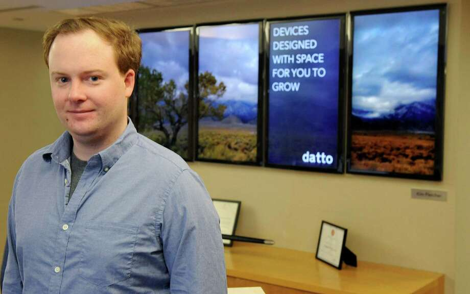Datto CEO Austin McChord in the company's Norwalk offices in February 2013. Photo: Lindsay Perry / Lindsay Perry / Stamford Advocate