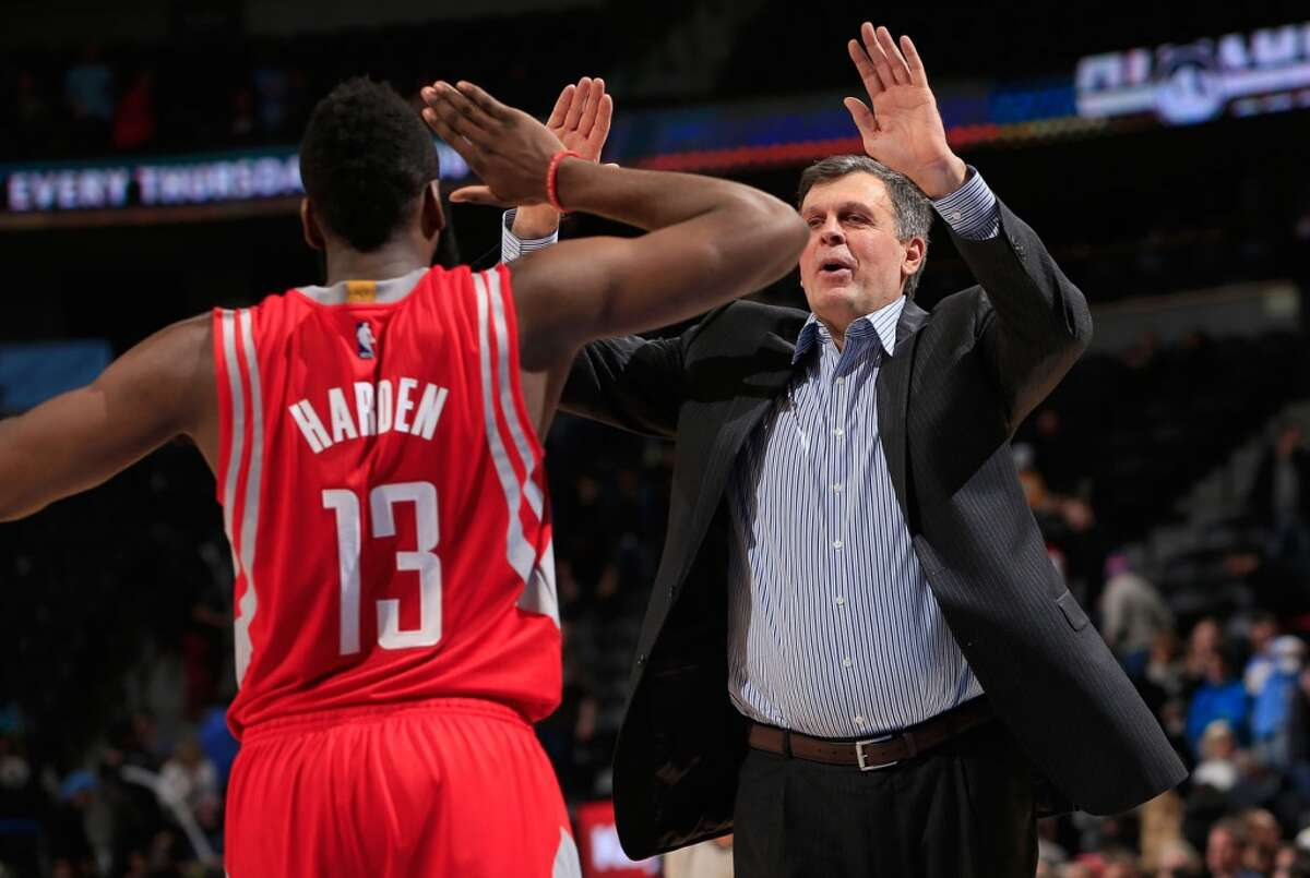 James Harden #13 of the Houston Rockets and head coach Kevin McHale of the Houston Rockets celebrate their victory over the Denver Nuggets at Pepsi Center on December 17, 2014 in Denver, Colorado.