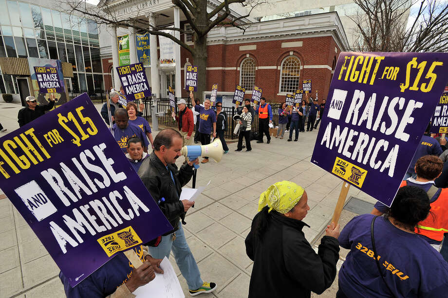 SEIU local 32BJ members and other low-wage workers take part in a rally in support of underpaid service workers in front of the Ferguson Library in April. Photo: Jason Rearick / Hearst Connecticut Media / Stamford Advocate