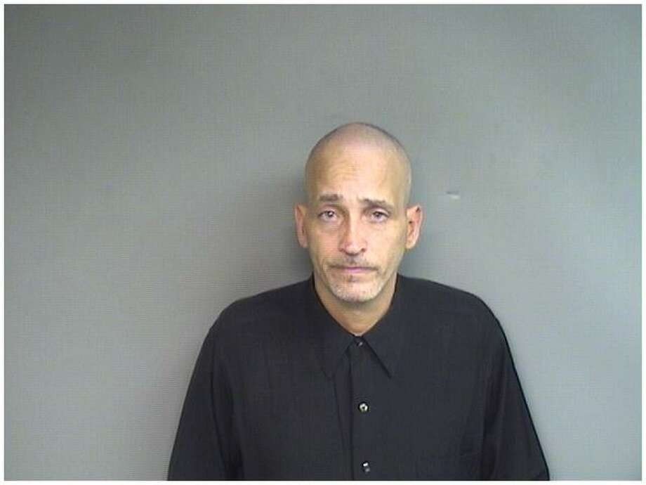 Angel Martinez, 49, of Bridgeport, was charged with cashing more than $4,000 worth of checks from Sterling Farms Golf Course in Stamford. Photo: Contributed Photo / Stamford Police / Stamford Advocate Contributed