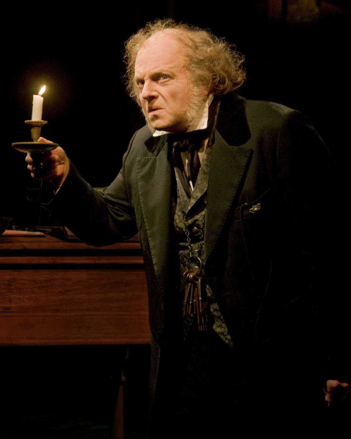 """Jeffrey Bean stars as Ebenezer Scrooge in the Alley Theatre's """"A Christmas Carol - A Ghost Story of Christmas."""""""
