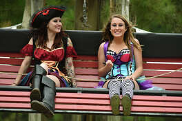 "Julie Solas, 27, left, and her sister Stevie, 18, both of Sugar Land, share a ride on ""Neptune's Swing""   at the Texas Renaissance Festival in Todd Mission on Saturday, Oct. 31, 2015. (Photo by Jerry Baker/Freelance)"