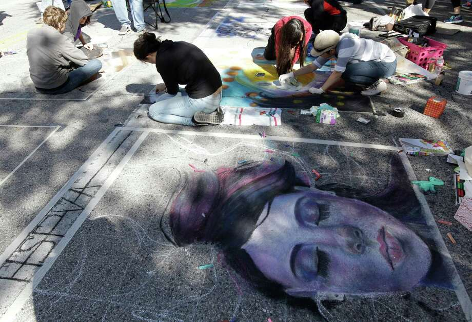 People work on murals during the Via Colori Street Painting Festival on the streets around Hermann Square Park at City Hall Sunday, Nov. 23, 2014, in Houston. ( Melissa Phillip / Houston Chronicle ) Photo: Melissa Phillip, Staff / © 2014  Houston Chronicle