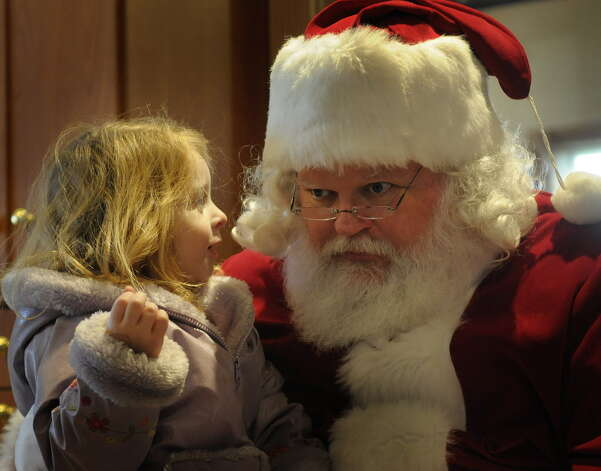 Billie Cioccke (cq), 3, leans in to tell Santa what she would like for Christmas at the Re-Nue Spa during the 10th Annual Altamont Victorian Holidays on Sunday, Dec. 11, 2011 in Altamont, NY.  The event also featured holiday house tours, a living nativity and the lighting of the village's holiday tree.   (Paul Buckowski / Times Union) Photo: Paul Buckowski / 10015717A