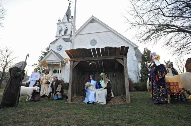 People sing Christmas songs at the living nativity at the 10th Annual Altamont Victorian Holidays event on Sunday, Dec. 11, 2011 in Altamon, N.Y.  (Lori Van Buren / Times Union) Photo: Lori Van Buren / 10015717A