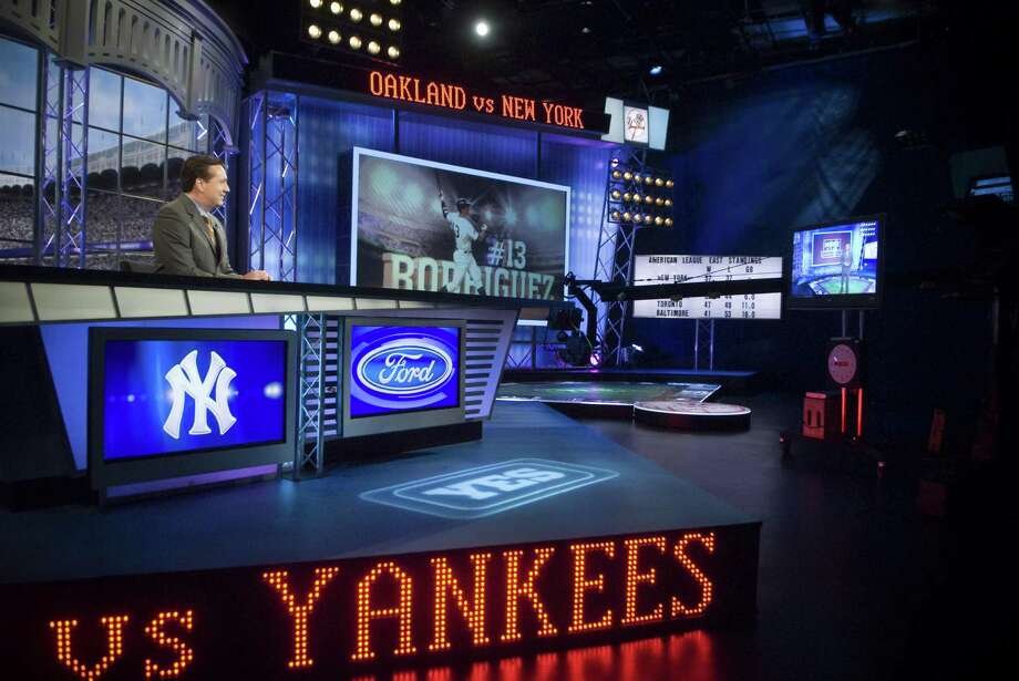 YES Network's Bob Lorenz anchoring a New York Yankees pre-game show at the network's studio in Stamford, Conn. in 2009. Photo: CHRIS PREOVOLOS / ST