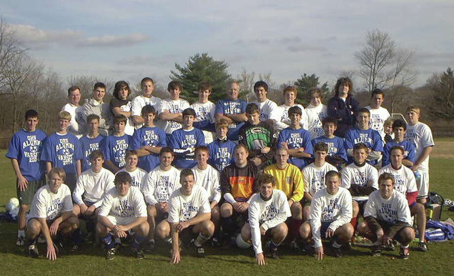 The Darien High School team and Alumni squad from last year. This year's game will take place Nov. 28 at Darien High School. Photo: Contributed / Darien News