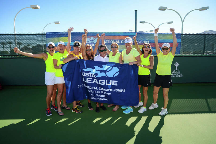 The Darien 40 and over team poses with the championship banner after taking the USTA title in California. Photo: Contributed / Darien News