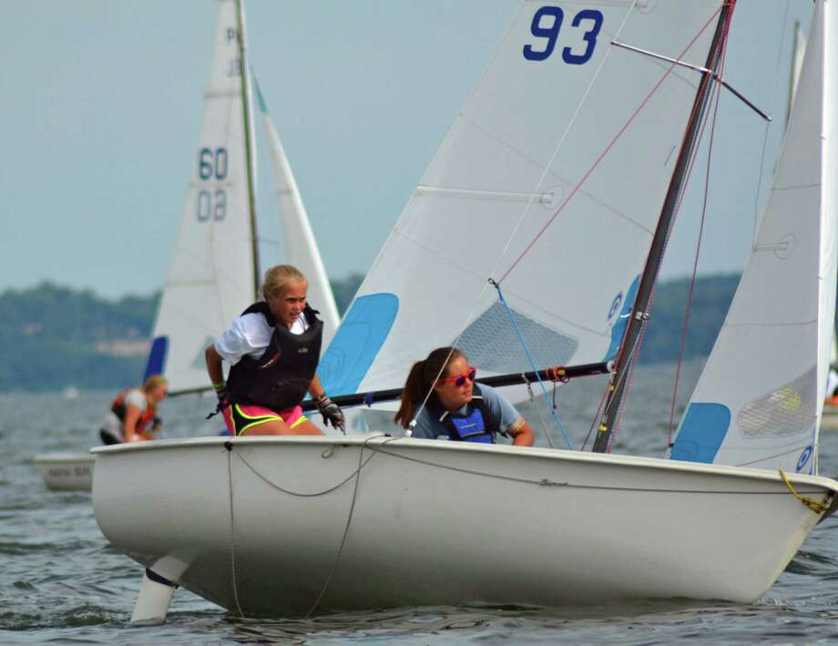 Devin Hart, skipper, and Madeline Dwyer, crew, sail during the JSA championships. Photo: Contributed / Darien News