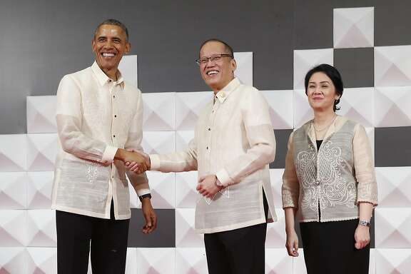 U.S. President Barack Obama, left, poses for a photograph with Philippines President Benigno Aquino III and his sister Maria Elena Aquino-Cruz at the welcoming dinner for the Asia-Pacific Economic Cooperation (APEC) summit in Manila, Philippines, Wednesday, Nov. 18, 2015. Leaders from 21 countries and self-governing territories are gathering in Manila for the Asia-Pacific Economic Cooperation summit. The meeting's official agenda is focused on trade, business and economic issues but terrorism, South China Sea disputes and climate change are also set to be in focus.