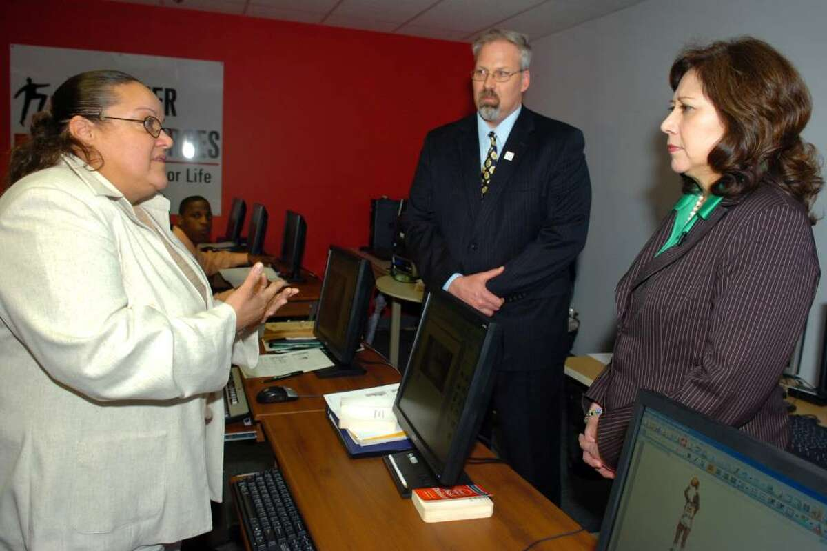 Zulma Vasquez, a client at The Workplace Inc. and Career Resources, speaks with U.S. Secretary of Labor Hilda Solis in Bridgeport, Conn. Monday, March 29th, 2010. They are seen here with Career Resources President/Ceo Scott Wilderman.