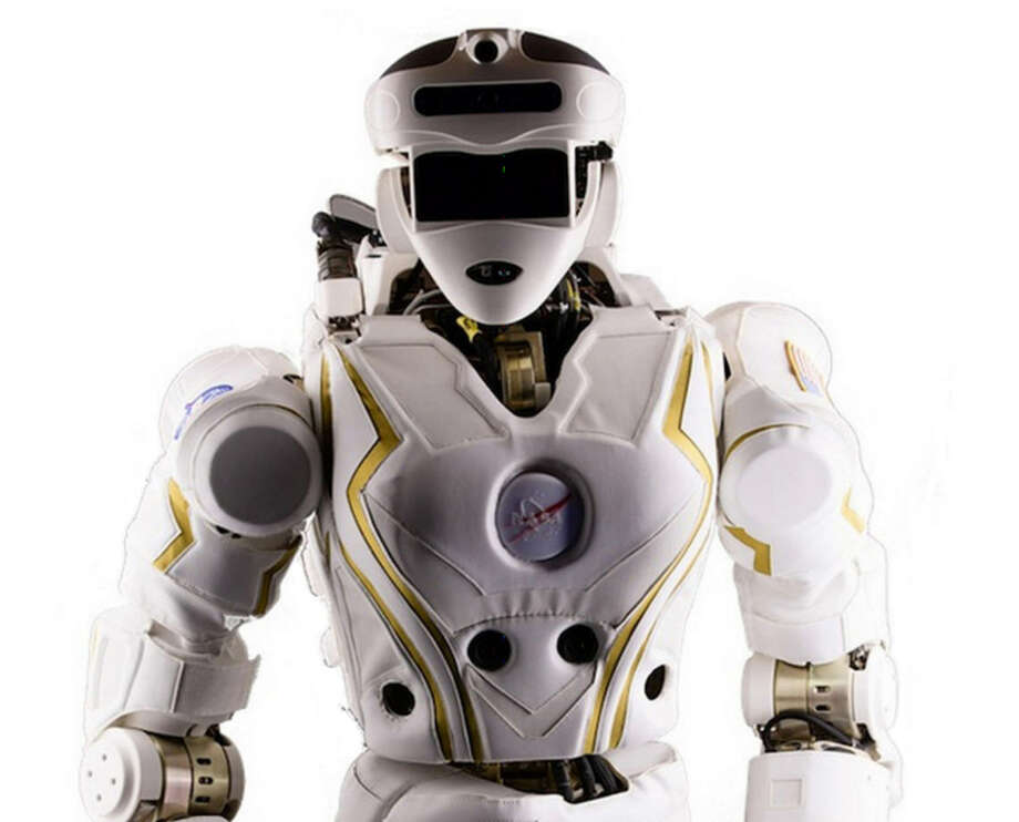 """The R5 will be intended to be used in future NASA missions """"either as percursor robots performing mission tasks before humans arrive or as human-assistive robots actively collaborating with the human crew.""""Source: NASA Photo: NASA"""