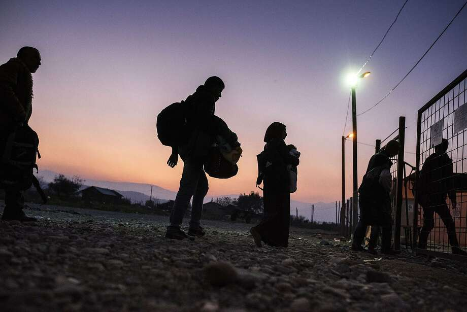 Migrants and refugees enter a registration camp after crossing the Greek-Macedonian border near Gevgelija on November 17, 2015. More than 800,000 refugees and migrants have landed in Europe so far this year and more than 3,000 have died while crossing the Mediterranean in search of a new life in the world's largest economy. Photo: Dimitar Dilkoff, AFP / Getty Images