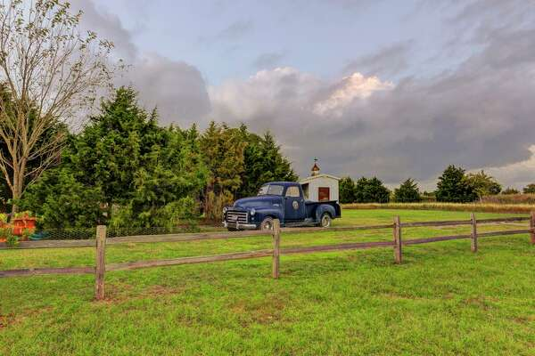 A vintage truck sits on near the Main House's driveway.