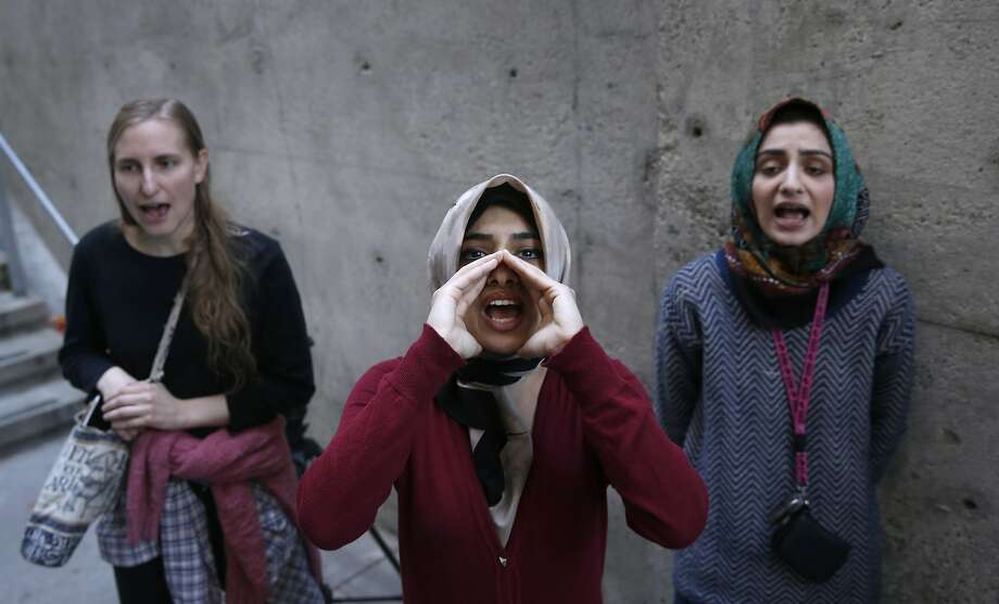 From left, Lisa Danz, Aarefah Mosavi and her sister Sayedah Mosavi protest outside Wada residence hall at UC Berkeley on Wednesday, Nov. 18, 2015 where a hearing is being conducted for a student appealing his expulsion from school after he was accused of raping a female student inside his dorm room in 2014. Photo: Paul Chinn, The Chronicle