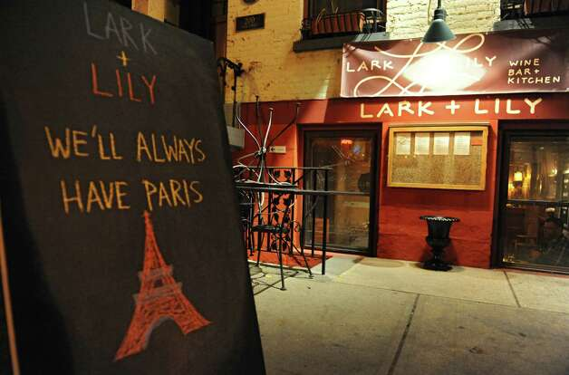Exterior of Lark & Lily Wine Bar and Kitchen where a group of French citizens gathered to talk about last weekOs terror attacks in Paris on Tuesday, Nov. 17, 2015 in Albany, N.Y. The french citizens living in the Capital Region came together in a very French act of defiance, restaurant owners in Paris are calling everyone to the bar or Otous au bistrot.O (Lori Van Buren / Times Union) Photo: Lori Van Buren / 10034323A