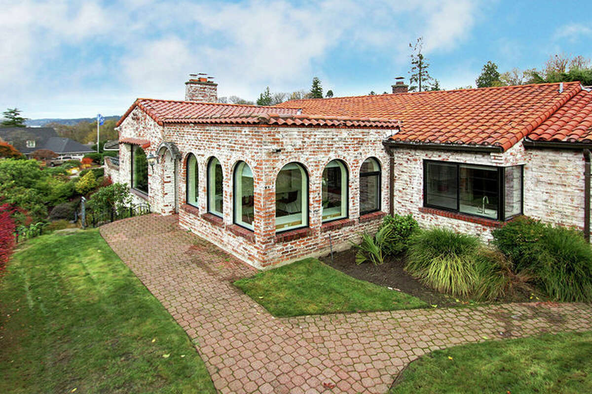 This home, 1543 N.W. Woodbine Wy., is listed for $1.175 million. This unique Spanish villa-inspired home has three bedrooms, 2.75 bathrooms and an adjoining home office with a private patio. Little details abound throughout this home, such as rounded archways and windows and beautiful Spanish tiling. You can see the full listing here.