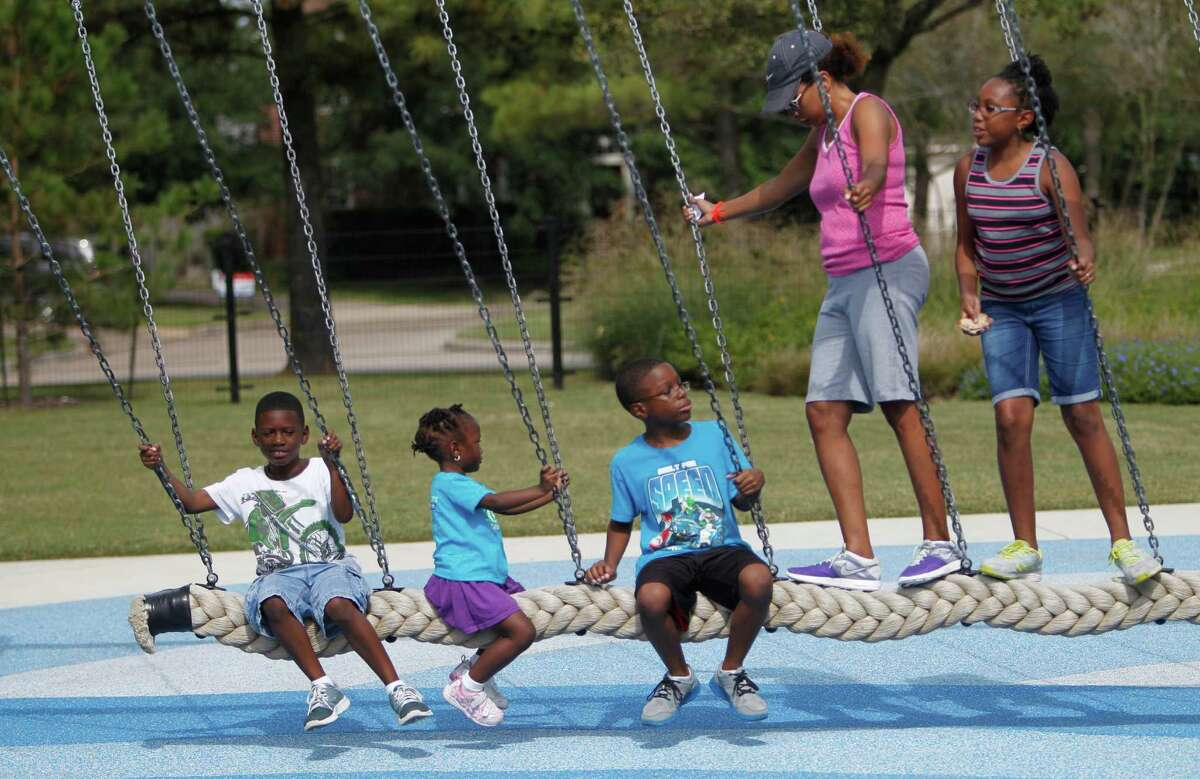 Andrea Rogers swings with her children, from left, Blake, 7, Eden, 3, Chase, 10, and Dylan, 11.