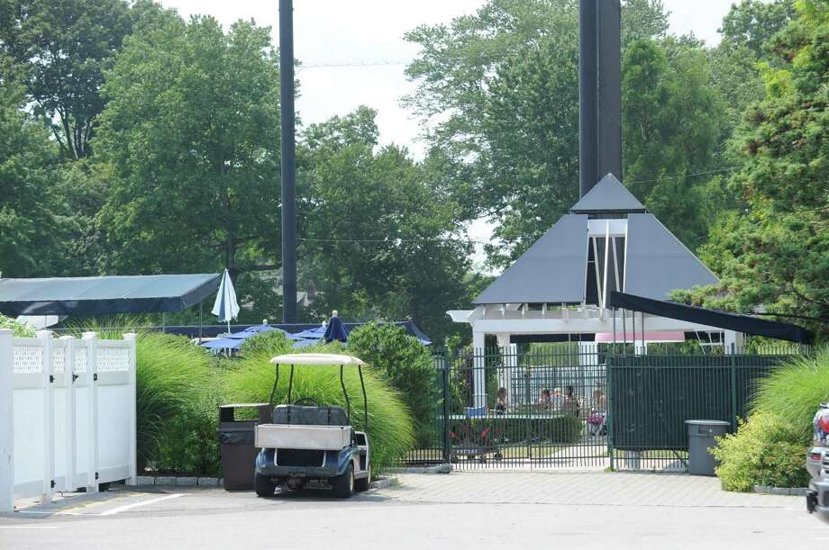 A view of the pool area at Innis Arden Golf Club as seen from Tomac Avenue, Old Greenwich, Tuesday, July 19, 2011.  The membership of of the town's second oldest club is scheduled to vote July 27 on whether to build a new aquatics and tennis facility to replace its current pool building on Tomac Avenue in Old Greenwich. Photo: Bob Luckey / Greenwich Time / Greenwich Time