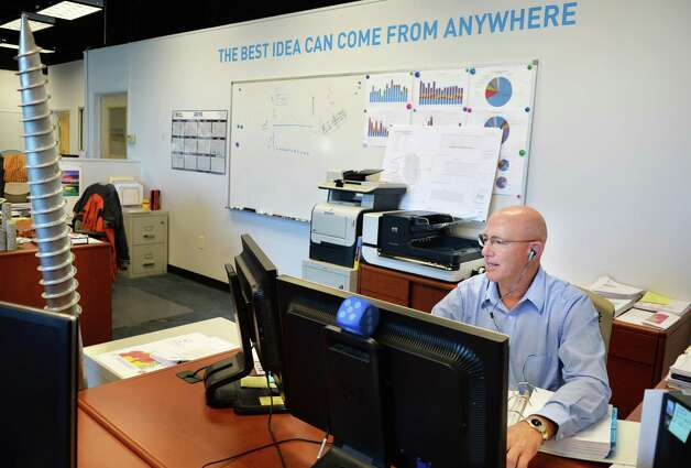 Operations manager Bill Heffernan in the offices of US Light Energy Tuesday Nov. 17, 2015 in Colonie, NY.  (John Carl D'Annibale / Times Union) Photo: John Carl D'Annibale / 10034299A