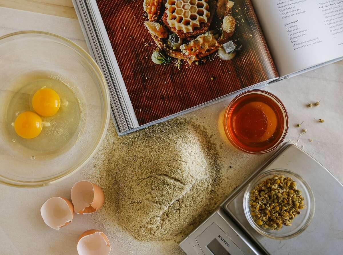 "Ingredients for honey chamomile cake and the, ""Atelier Crenn, Metamorphosis of Taste,"" cookbook are seen on Wednesday, Nov. 18, 2015 in San Francisco, Calif."